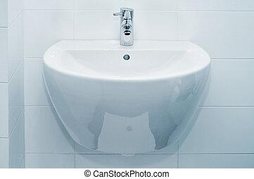 bathroom sink - a ceramic bathroom sink