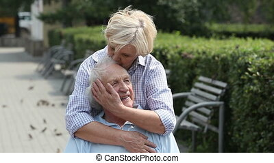Seniors in love - Lovely senior lady expressing love for her...