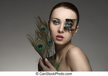 beauty portrait with peacock feathers - splendid naked...