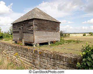 Old Shack - An image showing an old shack with a field in...
