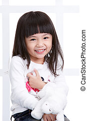 young asian girl smiling, white background