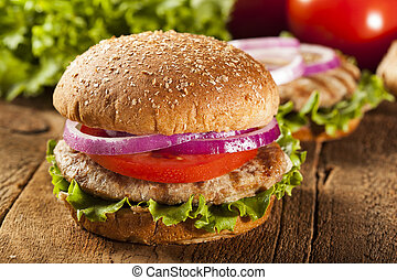 Homemade Turkey Burger on a Bun with Lettuce and Tomato