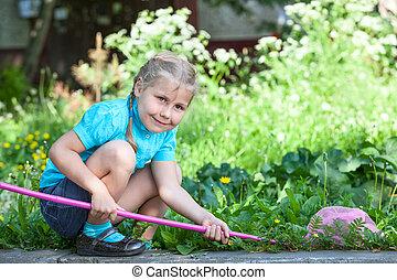 Preschooler Caucasian girl portrait when cathing butterfly...