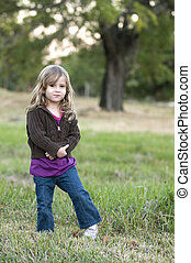 Girl in Field - Little girl posing in a  Field