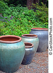 Big blue empty garden pots