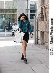 young attractive brunette woman walking on street city life...
