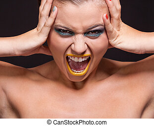 attractive young woman scream out loud with yellow lipstick...