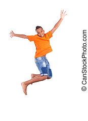 Portrait of a cute teenage black boy jumping over white...