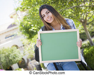 Excited Mixed Race Female Student Holding Blank Chalkboard -...