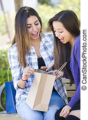 Young Adult Mixed Race Women Looking Into Their Shopping Bags