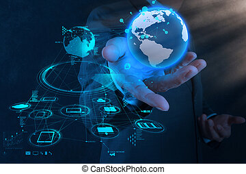 businessman hand working with new modern computer show the earth social network structure as concept