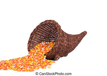 Cornucopia with Candy Corn - A wicker cornucopia filled with...