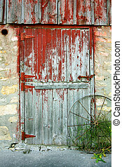 Old Barn Door - a rustic old barn door with peeling red...