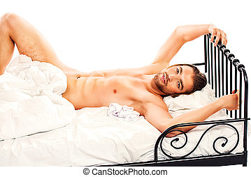 Casanova - Handsome nude man lying in a bed. Isolated over...