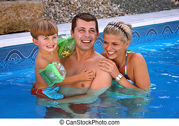 Young family in the pool