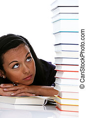 Young student learns a stack of books - Young woman with a...