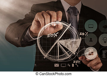 businessman hand drawing a pie chart