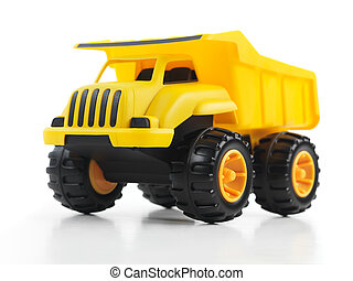 Toy dump truck - Yellow toy dump truck isolated on white...