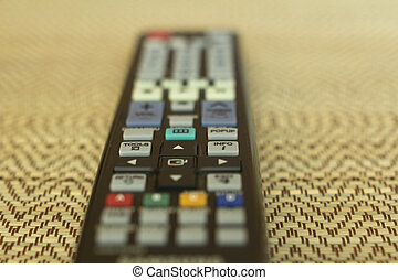 isolated object - The remote control on a straw background