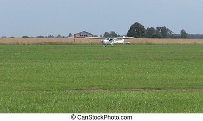 small aircraft on summer airfield grass