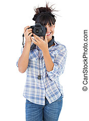 Young woman taking picture with her camera