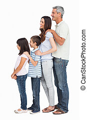 Portrait of a family in single file on white background