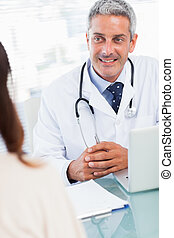 Doctor talking with his patient