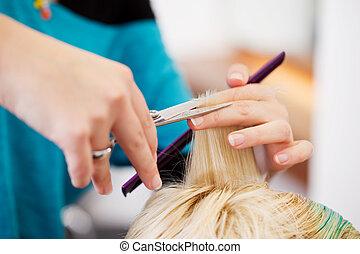 Hair Dresser Cutting Client's Hair In Salon - Closeup of...