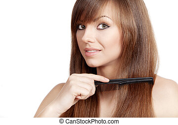 young brunette woman combs her hair