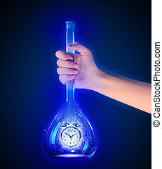 Alarm clock in tube - Human hand holding test tube with...