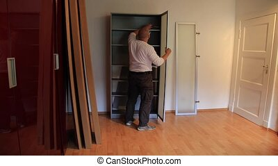 Male - Unmount Wardrobe - DIY - male cleans out a wardrobe...