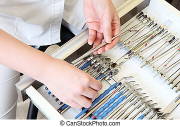 Dentist assistant organizes tools