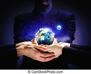 Earth planet in hands - Close up image of human hands...