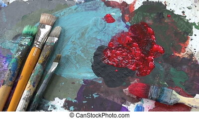 painter palette with red paint