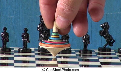 chess and colorful toy whirligig - black chess and colorful...