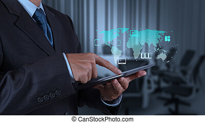 businessman hand using tablet computer and board room...