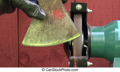 sharpening old axe on grinder - sharpening old axe on...