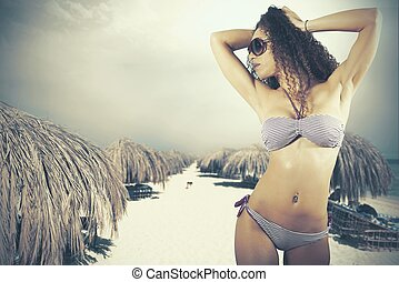 Girl at the beach - Concept of summertime with girl at the...