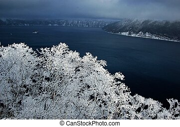Masyu Lake in winter,Hokkaido,Japan - Trees covered with...