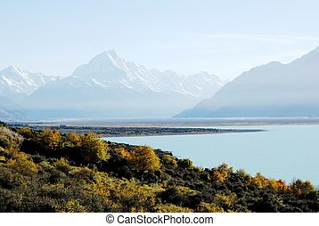 Mount Cook in autumn,New Zealand - Mount Cook and milky blue...