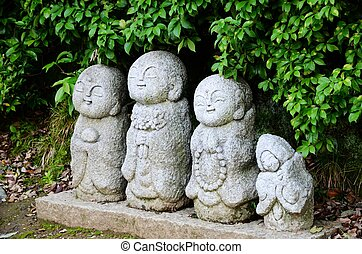 Stone statue of Jizo in Kyoto,Japan - Pretty stone statue of...