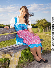 woman in bavarian traditional dirndl - A woman in bavarian...