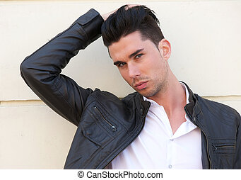 Attractive male model with hand in hair