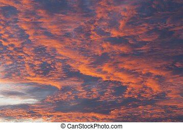 sky at the sunset - a orange sky and clouds at the time of...