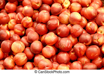 Peaches for sale at a marketplace
