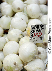 Fresh white onions for sale priced at 1.50 euro per kg
