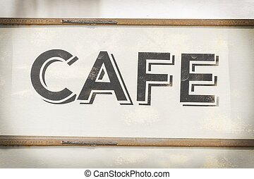Cafe sign along historic Kamouong street in Vang Vieng, Laos.