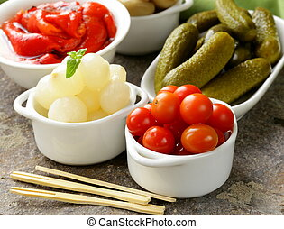 pickled snacks (tapas) - mushrooms, tomatoes, cucumbers and...