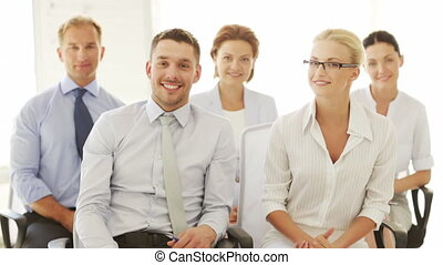 business people showing thumbs up - group of business people...