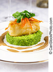 Sea bass - Chilean sea bass served with mashed pea and...